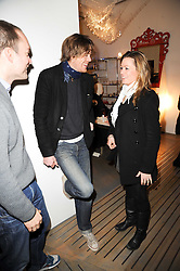 KRIS MARSHALL and HANNAH DODKIN at reception to raise funds for a Ugandan School Project supported by the Henry van Straubenzee Memorial Fund held at Few & Far, 242 Brompton Road, London SW3 on 11th February 2010.