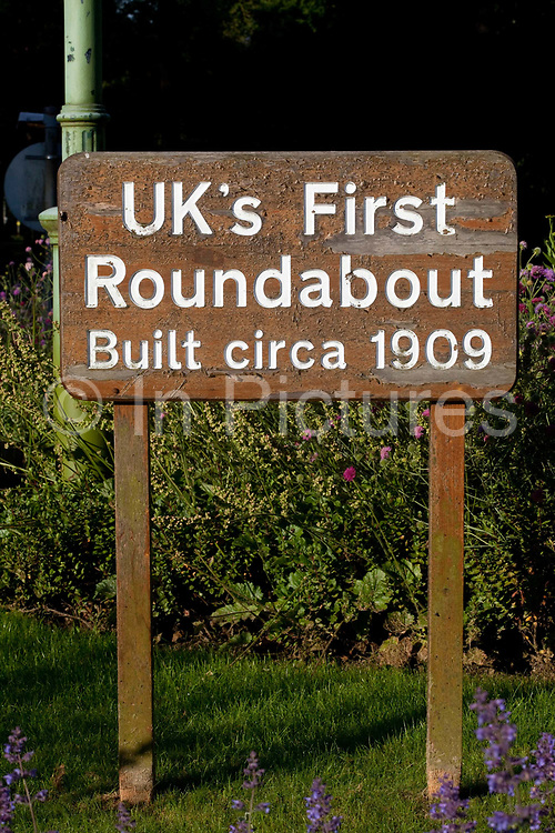 """Britains first roundabout built in c.1909. <br /> In 1898 Ebenezer Howard published his book """"Tomorrow: A Peaceful Path to Reform"""" (later """"Garden Cities of Tomorrow"""") founding the Garden Cities Association. His plan was to create a new, planned  settlement that combined the best of town and country - the first of which became Letchworth Garden City in 1903, laid out by architects Barry Parker and Raymond Unwin. It was followed in 1920 by a second garden city at Welwyn. The movement inspired Garden Cities in Europe and currently has been revived as a potential solution to Britain's housing crisis"""