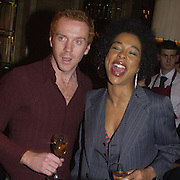 Damian Lewis and Sophie Okenedo, Krug Christmas party, hosted by Sir Trevor Nunn and Imogen Stubbs, the Criterion, 10 December 2003. © Copyright Photograph by Dafydd Jones 66 Stockwell Park Rd. London SW9 0DA Tel 020 7733 0108 www.dafjones.com