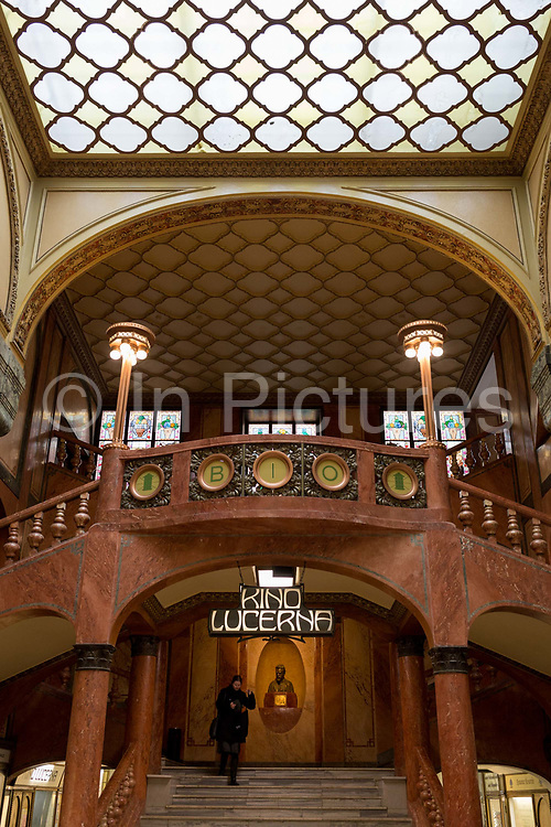 One staircase entrance to Kino Lucerna cinema in the marbled atrium kiosk in Lucerna Gallery, on 19th March, 2018, in Prague, the Czech Republic. Lucerna is the most elegant of Nove Mesto's many shopping arcades runs through the art-nouveau Lucerna Palace 1920, between Stepanska and Vodickova streets. The complex was designed by Vaclav Havel grandfather of the former president, and is still partially owned by the family. It includes theatres, a cinema, shops, a rock club and several cafes and restaurants. Here St Wenceslas sits astride a horse that is decidedly dead; it's safe to assume this is a reference to Vaclav Klaus, president of the Czech Republic from 2003 to 2013.