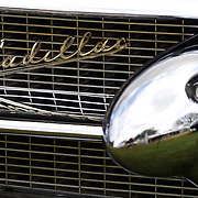 The emblem of a 1956 Cadillac Eldorado Biarritz at the Greenwich Concours d'Elegance Festival of Speed and Style featuring great classic vintage cars. Roger Sherman Baldwin Park, Greenwich, Connecticut, USA.  2nd June 2012. Photo Tim Clayton