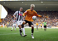 Photo: Rich Eaton.<br /> <br /> Wolverhampton Wanderers v West Bromwich Albion. Coca Cola Championship. 11/03/2007. Andy Keogh right of Wolves is tackled  by West Brom captain Curtis Davies