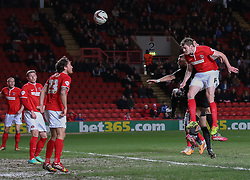 Charlton Athletic's Dorian Dervite comes close with this powerful header - Photo mandatory by-line: Robin White/JMP - Tel: Mobile: 07966 386802 18/03/2014 - SPORT - FOOTBALL - The Valley - Charlton - Charlton Athletic v Bournemouth - Sky Bet Championship