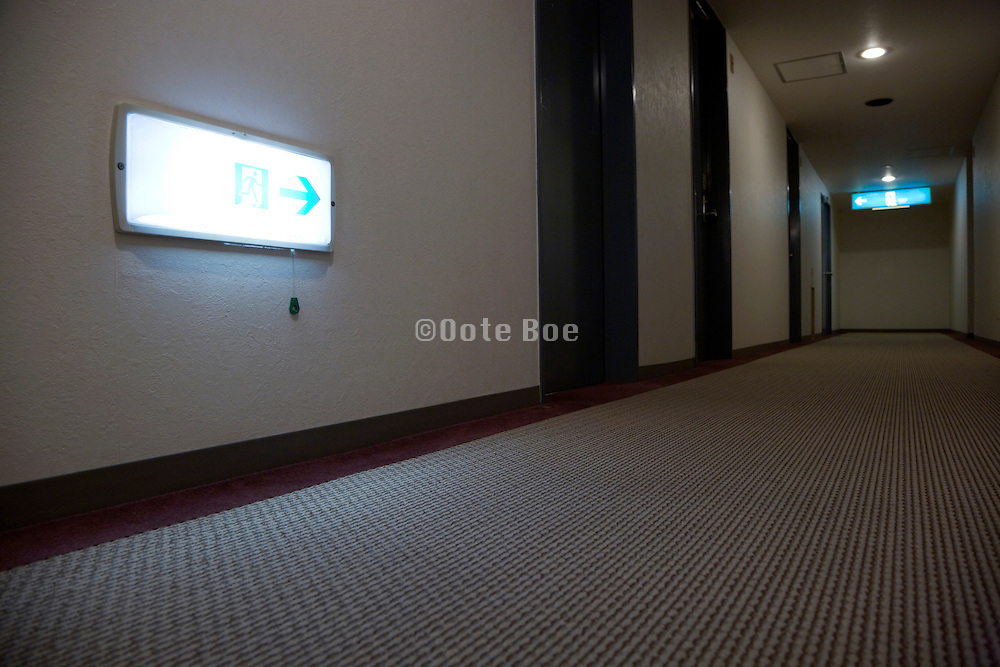 hotel hallway with footlight towards the fire escape stairwell