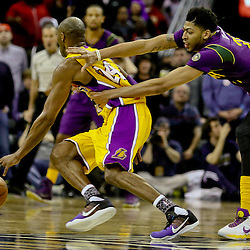 Feb 4, 2016; New Orleans, LA, USA; New Orleans Pelicans forward Anthony Davis (23) fouls Los Angeles Lakers forward Kobe Bryant (24) near the end of the fourth quarter of a game at the Smoothie King Center. The Lakers defeated the Pelicans 99-96. Mandatory Credit: Derick E. Hingle-USA TODAY Sports