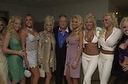 Hugh Hefner and Playboy Playmates. Talk pre-Golden Globes party. Mondrian Hotel. West Hollywood, California USA 20 January 2001. © Copyright Photograph by Dafydd Jones 66 Stockwell Park Rd. London SW9 0DA Tel 020 7733 0108 www.dafjones.com