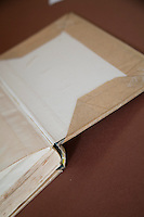 Old recipe book covered in brown paper