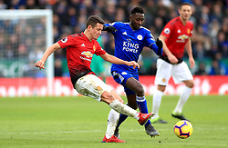 Manchester United's Ander Herrera (left) and Leicester City's Wilfred Ndidi battle for the ball during the Premier League match at the King Power Stadium, Leicester.