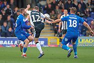 AFC Wimbledon midfielder Dylan Connolly (16) battles for possession with Gillingham defender Barry Fuller (12) during the EFL Sky Bet League 1 match between AFC Wimbledon and Gillingham at the Cherry Red Records Stadium, Kingston, England on 23 March 2019.