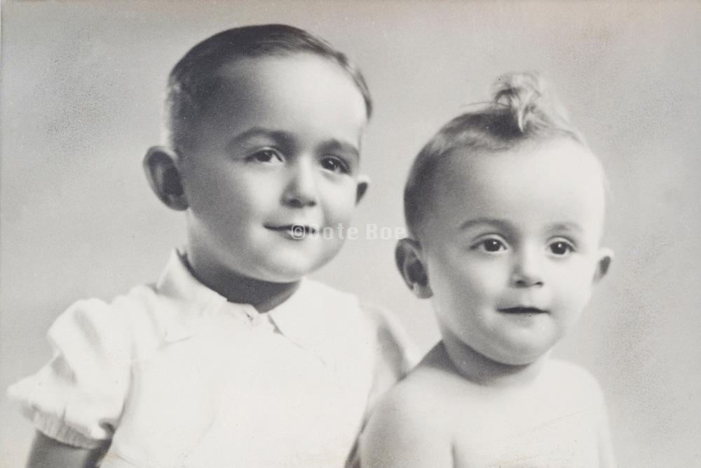 a classical portrait of two little children