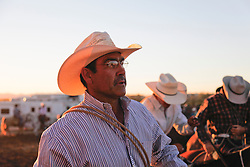 portrait of a rugged cowboy at a rodeo event