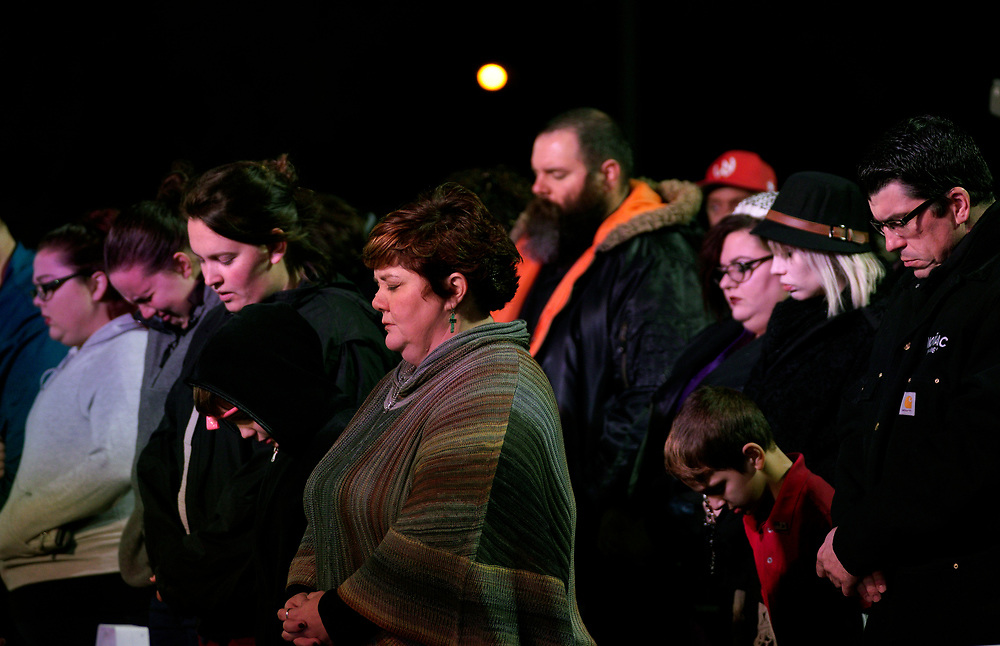 Families of victims in the First Baptist Church of Sutherland Springs shooting pray at a prayer vigil in Floresville, Texas, November 8, 2017.  REUTERS/Rick Wilking