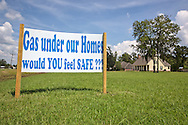 August 3, 2013, Bayou Corne, Louisiana , Protest sign on a resident's  lawn raising issue with the sinkhole that was created when a salt cavern being mined by Texas Brine Co. failed.<br /> Over the coarse of the year the sinkhole has grown from 3 acres to 24 acres. The residents of Bayou Corne have been under a mandatory evacuation for a year becuase the area has gas pressure under the community.