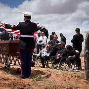 The American flag was folded and presented to family of Navajo Code Talker Fleming Begaye Sr. (right seated), May 17, 2019, during Begaye's interment at the family plot in Salt Water Canyon, Arizona.