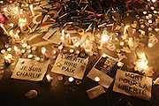 """""""Death for Freedom"""" & """"Freedom laughs at Peace"""". Protesters use candles and pens to mourn the dead journalists and cartoonists of Charlie Hebdo. A massive public demonstration took place in Place de la Republique, in central Paris, France; the evening after armed gunmen attacked the offices of Charlie Hebdo, killing twelve people, including the editor and celebrated cartoonists; four more are in critical condition. It is the dealiest terror attack in France for over fifty years. Charlie Hebdo is a satirical publication well known for its political cartoons. <br /><br />As a solidarity actions with the deaths at Charlie Hebdo many placards read """"Je suis Charlie"""" translating as """"I am Charlie (Hebdo)"""". Demonstrators held aloft pens, brushes and crayons, symbolizing the profession of journalists and cartoonists who were killed. Many pens were placed in a shrine with candles in the square"""