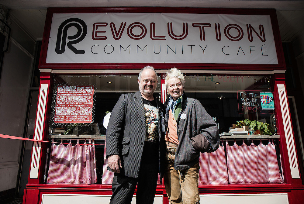 """Dame Vivienne Westwood with party leader Nigel Askew opens """"The Evolution Café,"""" by We are the Reality Party E on April 30. 2015.<br /> <br /> Dame Vivienne Westwood will be launching the new concept – The Evolution Café, by We are the Reality Party, whereby in return for assistance and sharing the work load – any family can ensure they are fed with nutritious, organic food grown on a local allotment.<br /> <br />  <br /> <br /> """"Good food doesn't need to be the preserve of the rich,"""" says Dame Vivienne Westwood.<br /> <br />  <br /> <br /> """"Nor do people need to feel that no one is looking out for them and they simply can't afford to put a good meal on the table"""".<br /> <br />  <br /> <br /> """"The Evolution Café is the Good Life. Not what David Cameron has tried to con Britons into believing, where people have their welfare cut and go starving"""".<br /> <br />  <br /> <br /> Dame Vivienne Westwood's son Joe Corré, is behind the concept. Corre has backed the Reality Party's campaign nationally and is financing the Evolution Café concept.<br /> <br />  <br /> <br /> He believes the Community Café concept can be rolled out to other areas, with Thanet South acting as a model.<br /> <br />  <br /> <br /> The Evolution Café is the first Community Café in the area, adhering to Happy Monday's Bez's philosophies of Perma Culture, or 'grow it and eat it and then grow it again'.<br /> <br />  <br /> <br /> According to Dame Vivienne Westwood: """"Ramsgate, part of Thanet South, is a place that has been preyed upon by UKIP because they believe that problems can be explained away by pointing fingers at others"""".<br /> <br />  <br /> <br /> """"The reality is community's like Ramsgate in Thanet South, need to look to each other for support and help"""".<br /> <br />  <br /> <br /> """"The Evolution café is a fantastic concept I support"""".<br /> <br />  <br /> <br /> The owner of the Café, Nigel Askew, is the Real Pub Landlord and is a candidate for We are the Reality Party in South Thanet. He's """
