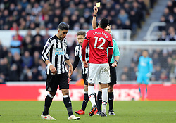 Manchester United's Chris Smalling receives a yellow card during the Premier League match at St James' Park, Newcastle.