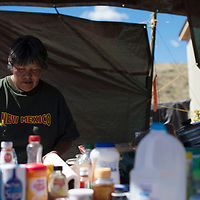 091814      Cayla Nimmo<br /> <br /> Bessie Williams cooks lunch out of her makeshiftt outdoor kitchen for the volunteer construction workers building her house on Thursday in Bennett Freeze.