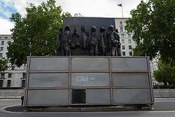 © Licensed to London News Pictures. 14/06/2020. London, UK. The Monument to the Women of World War II in Whitehall remains boarded up .Several Monuments and statues were boarded up ahead of this weekends protests . Photo credit: George Cracknell Wright/LNP