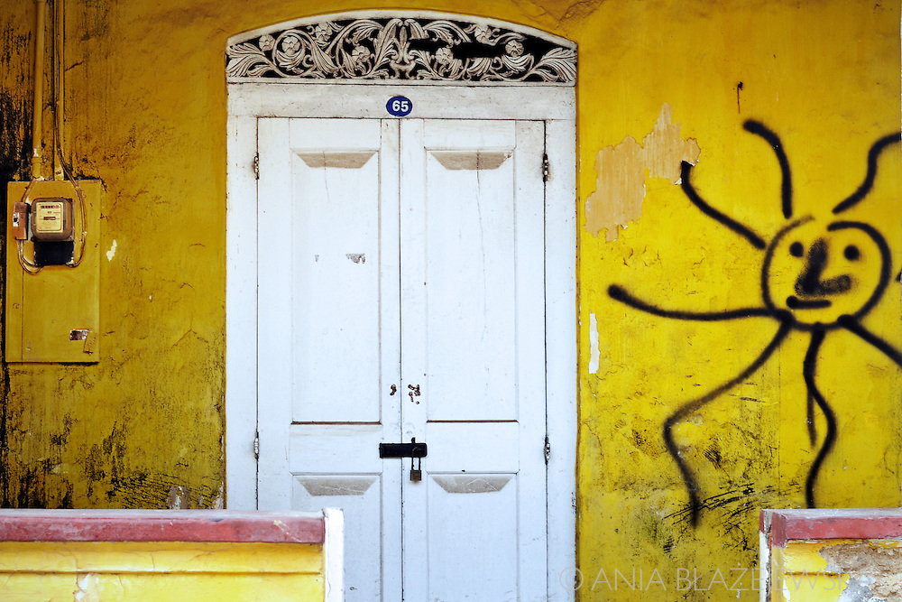 Sri Lanka. Old white door and yellow wall  in Galle.