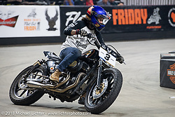 Hooligan Jason Rodgers on his 1996 Harley-Davidson Sportster races into turn one at the Flat Out Friday flat track racing on the Dr. Pepper-covered track in the UW-Milwaukee Panther Arena during the Harley-Davidson 115th Anniversary Celebration event. Milwaukee, WI. USA. Friday August 31, 2018. Photography ©2018 Michael Lichter.