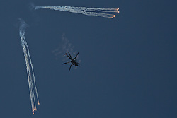 26/03/2017. Mosul, Iraq. An Iraqi Army Aviation Mi-28 Havoc fires rockets at Islamic State positions in West Mosul as it supports Iraqi troops fighting in the city.<br /> <br /> Iraqi forces reported today that one of its attack helicopters, supporting the ongoing Mosul Offensive, was shot down by Islamic State militants.