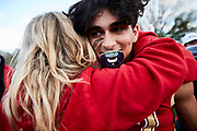 ORADELL, NJ - December 5: Bergen Catholic's Justan Luzzi hugs his mother after they win their last game of the season in Oradell, New Jersey. <br /> <br /> We are in the midst of witnessing something this world has never experienced - a global pandemic. The coronavirus has swept away the world in March of 2020 - since then, the world we know It hasn't been the same. Jobs, businesses and futures have been put on hold and lost, yet, we have to power through to overcome one of the greatest obstacles this we have faced. The high school football season wasn't suppose to happen, but a glimmer of hope, intense safety measures & a little bit of luck has allowed for the season to start, now the question is ' Can It be completed?'<br /> <br /> Photo by Johnnie Izquierdo