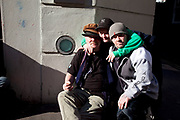 Street drinkers outside a homeless hostel in Soho, central London.