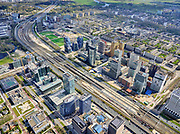 Nederland, Noord-Holland, Amsterdam; 17-04-2021; Zuidas rond het Zuidplein. Tussen de hoogbouw station Zuid-WTC, het Zuidasdok met aan weerszijden de autosnelweg Ring A10. Rechts Buitenveldert.<br /> Zuidas around the Zuidplein. Between the Zuid-WTC high-rise station, the Zuidasdok with the Ring A10 motorway on both sides. Right Buitenveldert.<br /> luchtfoto (toeslag op standaard tarieven);<br /> aerial photo (additional fee required)<br /> copyright © 2021 foto/photo Siebe Swart