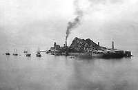 Gunkanjima Island 1905 - Hashima Island once had a population of 5000 coal miners, but was abandoned in 1974. The island was left to the elements, now serving as a time capsule of the past.  A cameo role in the 007 James Bond Skyfall movie put it back on the map.  It is often called Gunkanjima or battleship island because of its shape.  Before the place became famous, it was slated to become a huge trash pit, but preservationists put that to a stop. Alighting from the boat onto the island is like entering a sci-fi scenario or a video game with crumbling and ruined concrete apartment buildings and collapsing brick stairways, twisted metal girders and plant life growing in the cracks.  Many sites on the island are prohibited because of safety reasons, though the place and its sad history spooks many people out.