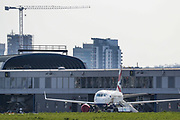 British Airways planes are seen parked up at London City Airport, in east London, Saturday, March 28, 2020, the airport is closed for commercial traffic at least until the end of April. The airport is next to the ExCel Centre and may be used to help with logistics as the British Government announced on Tuesday, that the ExCel Center in east London will become a 4,000-bed temporary hospital to deal with future coronavirus patients. (Photo/Vudi Xhymshiti)