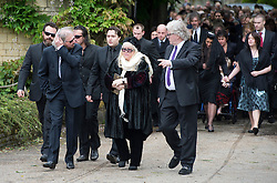 © London News Pictures. 08/06/2012. Thame, UK.  Barry Gibb (brother), Robin?John Gibb (son) and Dwina Gibb (wife), leaving the home of former Bee Gee Robin Gibb on their way to St Mary's Church in Thame, Oxfordshire for the funeral of Robin Gibb on June 8, 2012. Robin Gibb died on May 20, 2012 aged 62 following a long battle against cancer. Photo credit: Ben Cawthra/LNP