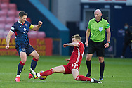 Iain Vigurs of Ross County gets tackled by Ross McRorie of Aberdeen during the Scottish Premiership match between Ross County FC and Aberdeen FC at the Global Energy Stadium, Dingwall, Scotland on 16 January 2021.