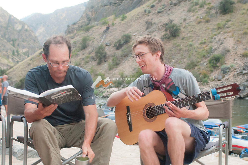 Live music at Otter Bar in The Impassible Canyon on the Middle Fork of the Salmon River during six day rafting vacation, Idaho.