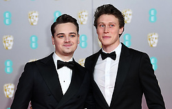 Dean Charles Chapman and George MacKay ttending the 73rd British Academy Film Awards held at the Royal Albert Hall, London. Photo credit should read: Doug Peters/EMPICS Entertainment