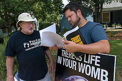 Pro-life activist Keith Dalton, 28, right, speaks with fellow activist James Portrus, 64, near the Jackson Women's Health Organization clinic, on Tuesday August 19, 2014, in Jackson, Mississippi. Portrus, is not allowed within 150 feet of the clinic due a court issued restraining order. This is the only clinic in the entire state that performs abortions. (Photo © Jock Fistick)
