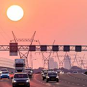 NLD/Muiden/20160830 - De nieuw rijksweg A1 in de ondergaande avondzon