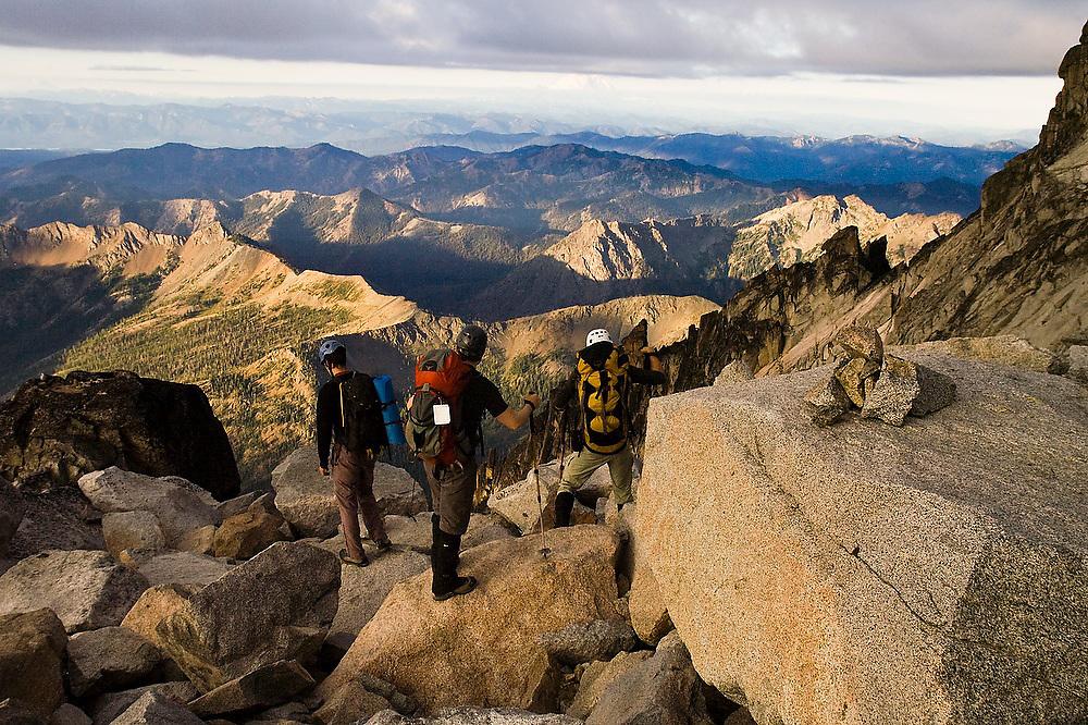 Climbers descend the Cascadian Couloir on Mount Stuart, Alpine Lakes Wilderness, Washington.