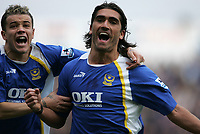 Photo: Lee Earle.<br /> Portsmouth v Manchester City. The Barclays Premiership. 11/03/2006. Pompey's Andres D'Alessandro (L) celebrates with Pedro Mendes after he scored the opening goal.
