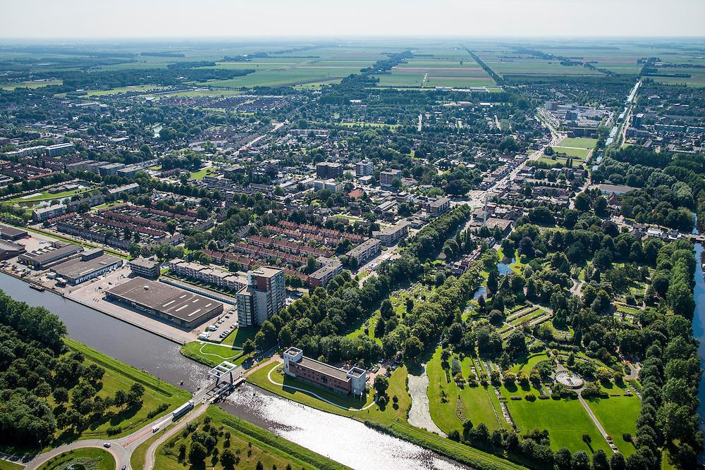 Nederland, Groningen, Hoogezand-Sappemeer, 27-08-2013;<br /> Zicht in zuidelijke richting. Kerkstraat (N385) in Hoogezand kruist het Winschoterdiep. Rechts beneden begraafplaats De Stille Hof. <br /> Aan de horizon het platteland van Groningen.<br /> The village of Hoogezand-Sappemeer in the north of the Netherlands.<br /> luchtfoto (toeslag op standaard tarieven);<br /> aerial photo (additional fee required);<br /> copyright foto/photo Siebe Swart.