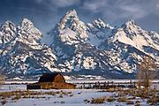 Teton National Park-The Grand Teton mountains tower over a rustic barn along Mormon Row, near Grand Teton National Park in Wyoming.