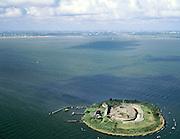 Nederland, Noord-Holland, Pampus, 25-09-2002; Forteiland Pampus, onderdeel van de Stelling van Amsterdam; rond het eiland ligt - onder water - een krans van stenen ter verdediging, herkenbaar aan de witte koppen op de golfjes; het gele scheepje in de haven van het fort is het bevoorradingsschip; aan de horizon links IJburg, rechts Durgerdam; weer, cumulus, stapelwolken; geschut, artillerie, Eerste Wereldoorlog, mobilisatie; wereld erfgoed (Unesco), cultureel erfgoed, monument; zie ook andere (detail)foto's van deze lokatie;<br /> luchtfoto (toeslag), aerial photo (additional fee)<br /> foto /photo Siebe Swart