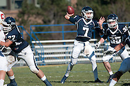 The quarterback for Ithaca College turns and throws towards the sideline.