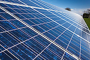 Close up view of photovoltaic solar panels in a field for electricity production.