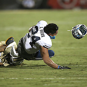 ORLANDO, FL - OCTOBER 09:  Algernon Brown #24 of the Brigham Young Cougars has his helmet fly off after a tackle by Jordan Ozerities #38 of the UCF Knights at Bright House Networks Stadium on October 9, 2014 in Orlando, Florida. (Photo by Alex Menendez/Getty Images) *** Local Caption *** Algernon Brown; Jordan Ozerities