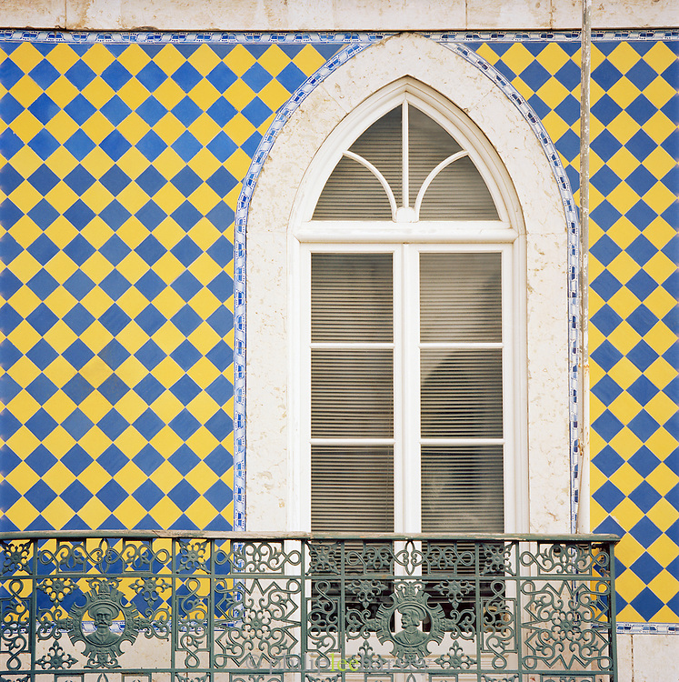 A window decorated with coloured tiles in Lisbon, Portugal