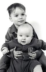 Studio portrait of small boy & baby UK 1990s