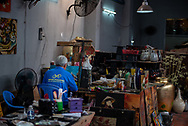 Ho Chi Minh City, Vietnam -- March 19, 2016. Photo of an artist working in a small studio in Ho Chi Minh City.