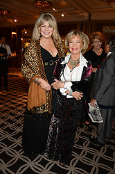 CAROL ASHBY and LIZ MORGAN at the 90th birthday party for Nicholas Parsons held at the Hyatt Churchill Hotel, Portman Square, London on 8th October 2013.