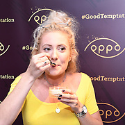 Marcus Verrell , Zoe Rolph blogger @zoefit_uk tasting a Raspberry Cheesecakes, served with Skinny Prosecco at Farm Girls Café, 1 Carnaby Street, Soho, London, UK on July 18 2018.